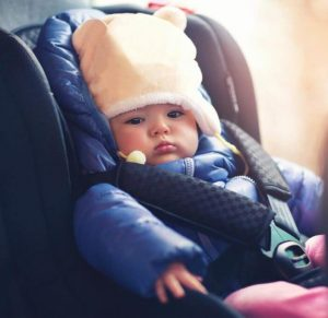 Why puffy winter coats compromise car seat safety