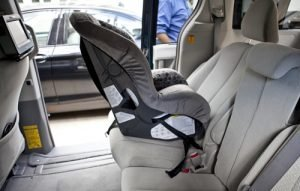 Rear facing car seat installed without covering it with a car seat protector